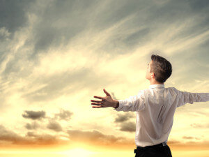 Man arms outstretched facing sky