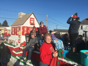 Hancock County Savings Bank employees and their families sitting on the Banks' Christmas float.