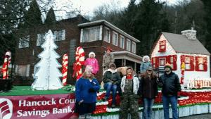 Hancock County Savings Bank employees and their families at New Cumberland Christmas Parade.