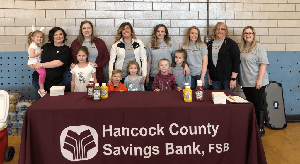 Hancock County Savings bank Employees and their children participate in the 2018 Easter Egg Hunt.