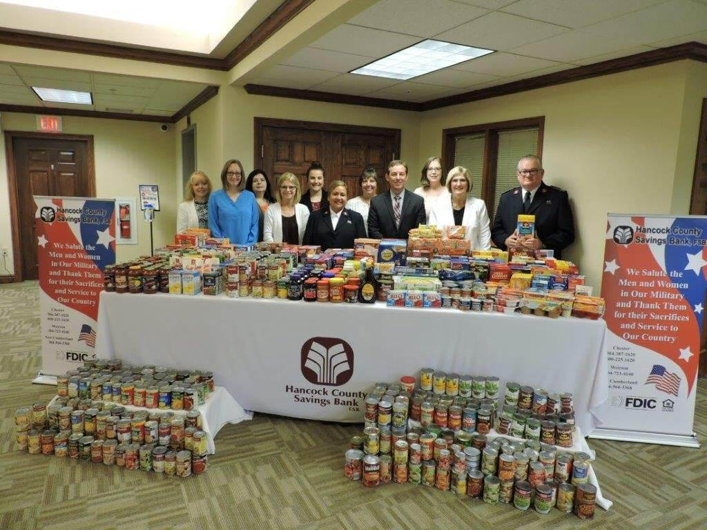 HCSB Employees pose in front of donation table for Salvation Army
