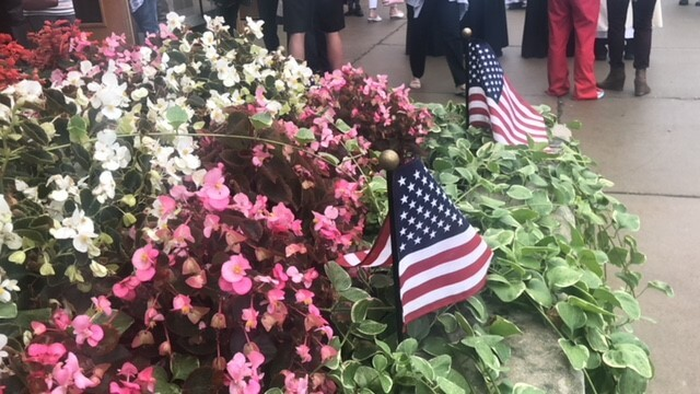 Bed of flowers with American Flags
