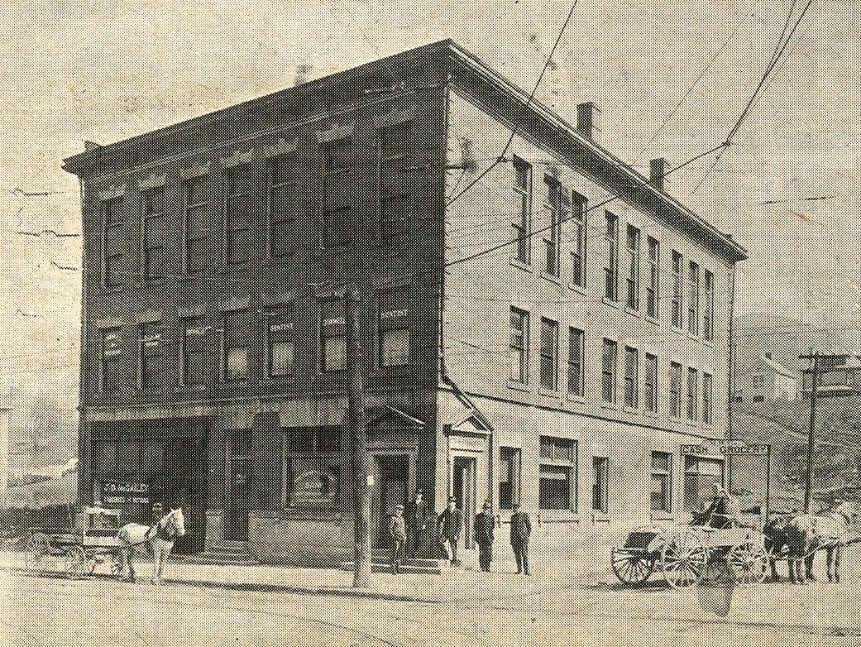 old photo of a corner building