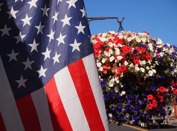 labor day flag and flowers