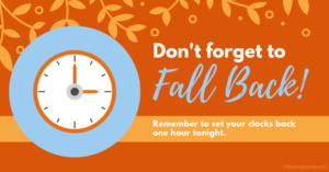 clock with banner stating don't forget to fall back
