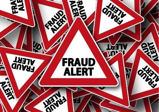 fraud alert triangle sign
